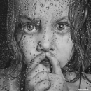 Patiently ... (Young girl looking through window with raindrops)