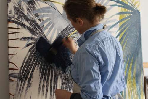 Marianne Nix applying Oil glaze